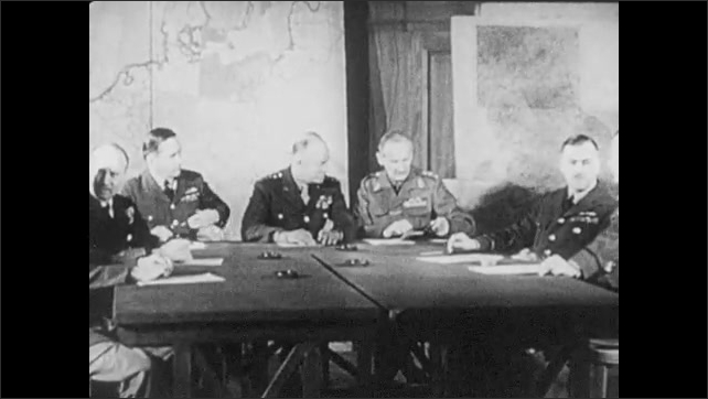 1940s: 3 male telephone operators at switchboard. Soldier pulls long paper out of machine. Eisenhower, Bernard Montgomery and other commanders sit at a table in front of maps.