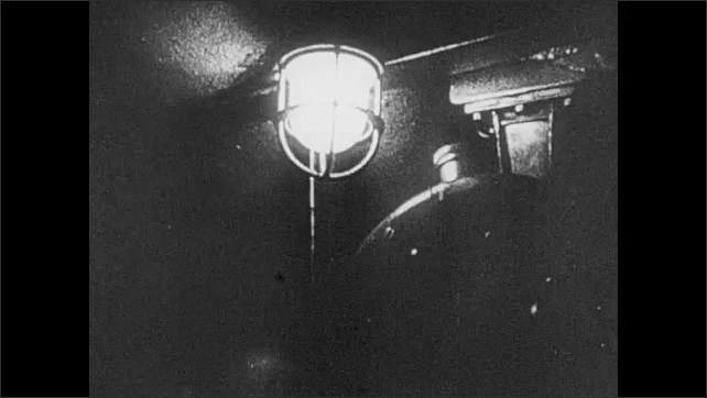 1940s: Airplanes overhead in formation. German satellite dish turns. German speaks into headset. A light flashes. A beam of light across the sky. Gunshots into the night sky. Machine gun turret fires.