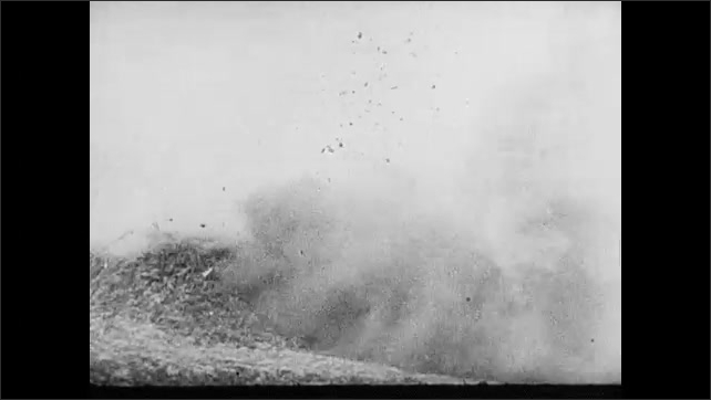 1940s: Cannons from allied battleships emit clouds of smoke. Explosions on the beach. Cannons shoot. Explosions in the water. Allied airplane flying.
