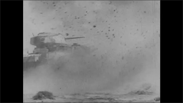 1940s: Soldiers and lance of tanks move through desert. Explosions erupt around tanks. Soldiers fire cannon. Soldiers with rifles run through dust cloud.