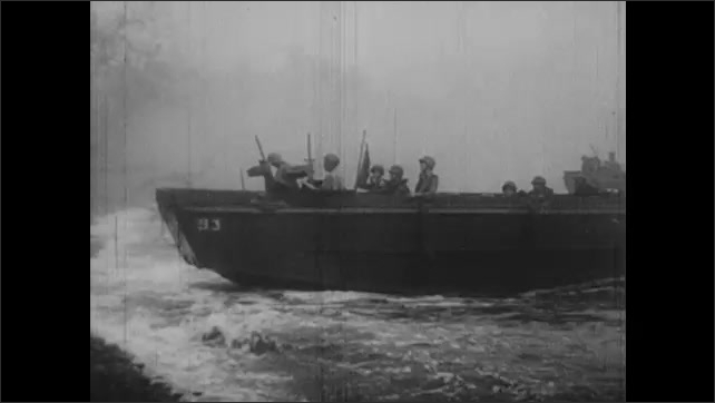 1940s: Cannons on battleships fire. Soldiers pour from PT boats onto shores. Soldiers run through water onto beach.