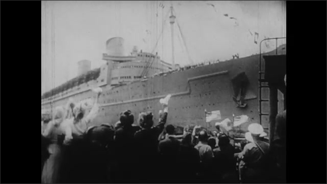 1940s: Japanese generals and representatives sign formal surrender papers. Crowds wave as ship enters harbor. Soldiers march and dance in tickertape parade.