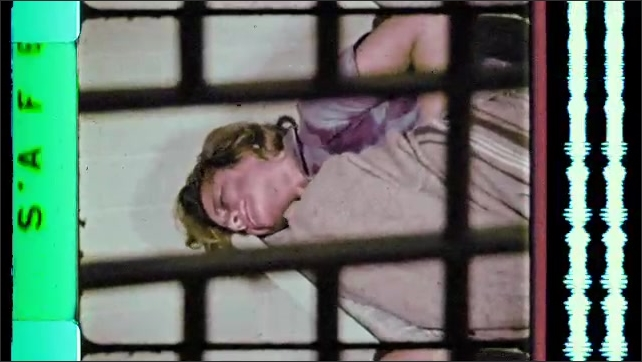 1960s: Girl grimaces and writhed in prison cell bed. Girl experiences drug withdrawal.