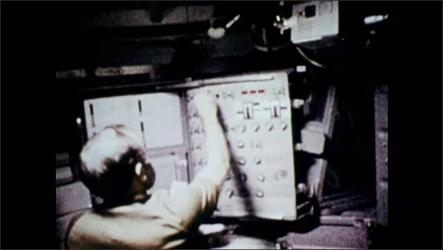 1970s: View of earth from space. Astronauts working inside space shuttle.