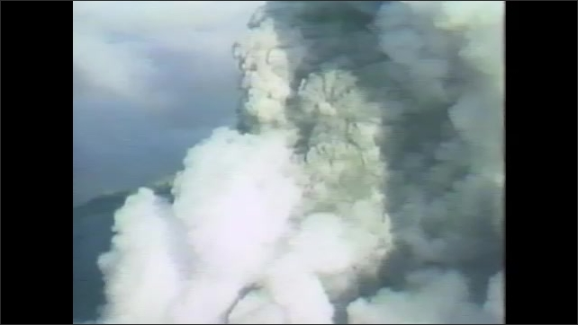 1970s: Aerial images of Earth from space. Mount St. Helen's erupting. Earth survey aircraft lands on runway.