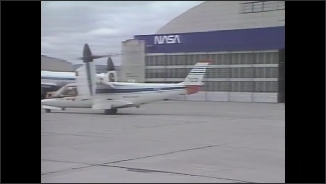 1970s: NASA tilted rotor airplane taxis down runway at Ames Research Center. Titled rotor airplane lifts vertically from runway.