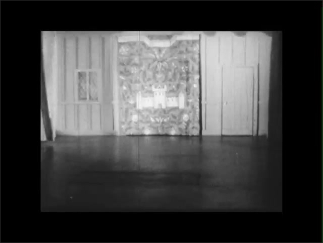 1950s: EUROPE: ENGLAND: The Study. Room in Elizabethan house. Wall hanging on stage. Furniture on stage. Curtained inner stage