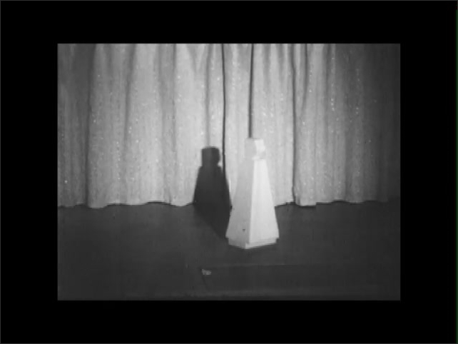 1950s: EUROPE: ENGLAND: curtain on stage. Model of actor drops from above. Stage cover and trap door.