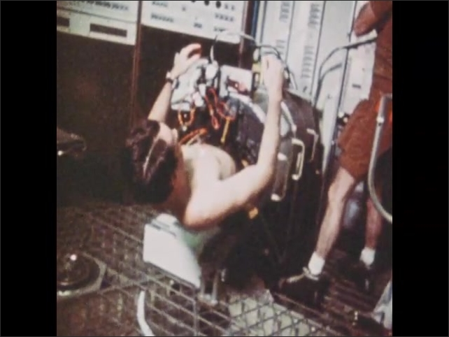 1970s: Man lays inside tube, bangs on tube.