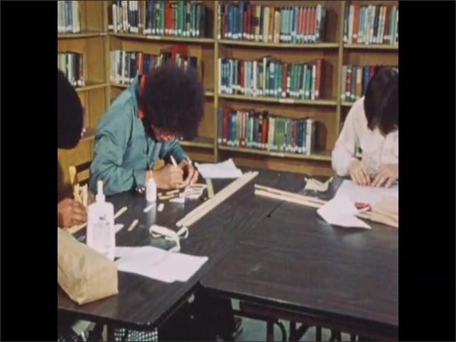 1970s: Students build stick bridges.