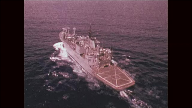1970s: UNITED STATES: flight over a military ship at sea. USS Indianapolis (CA-35)
