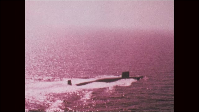 1970s: UNITED STATES: USS Whale (SSN-638) submarine travels along surface of ocean.