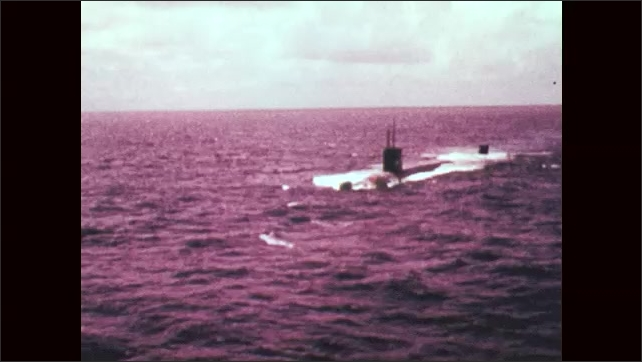 1970s: UNITED STATES: Overhead view of USS Whale (SSN-638) submarine at surface of ocean.