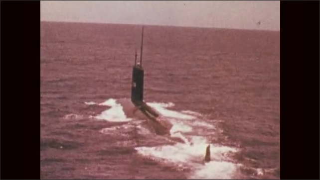 1970s: UNITED STATES: USS Scamp (SSN-588) in ocean. Title number forty two. Dock at night