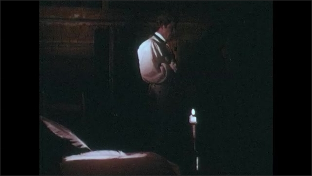 1970s: Men with firearms patrol. Man reads letter by candlelight.