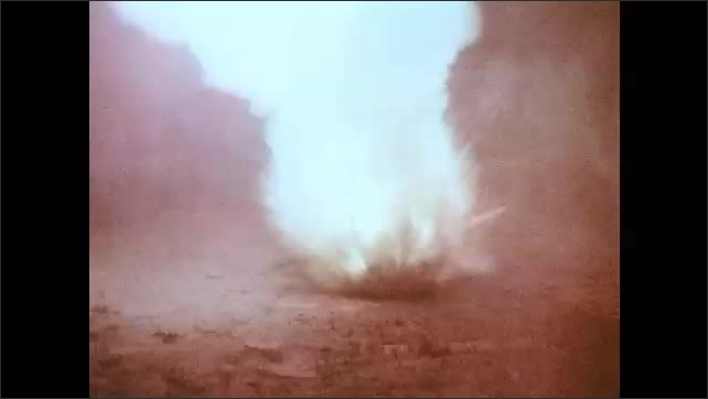 1970s: Large explosions. Soldiers hide in bunker.