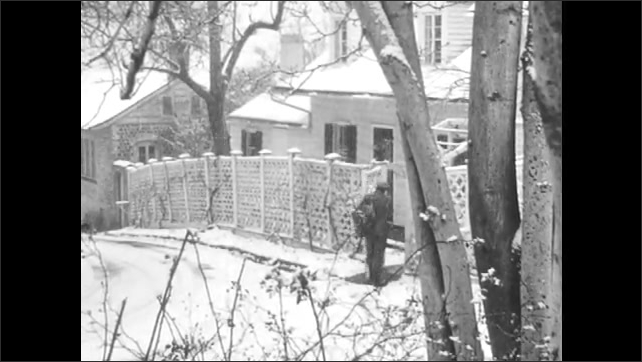 1960s: Mailman walks down snowy street.  Boy lays in bed.  Man opens gate.  Man climbs steps and knocks on door.
