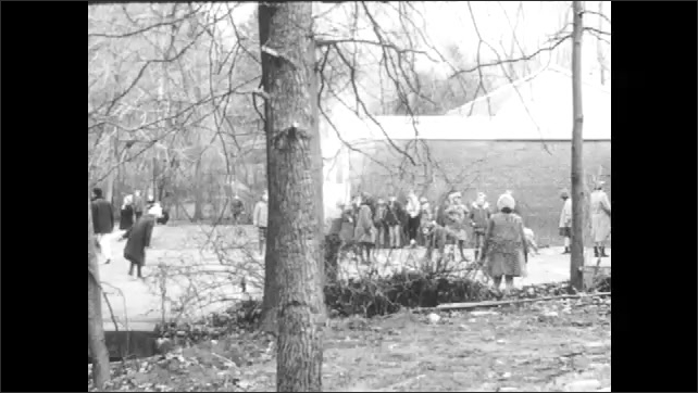 1960s: Boy stands and speaks.  Children play during recess.  Kids leave school at the end of the day.