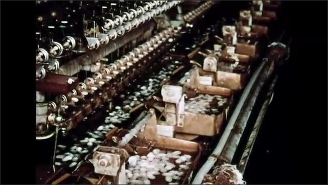1960s: Machine moves baskets of cocoons. Machines winding silk thread.