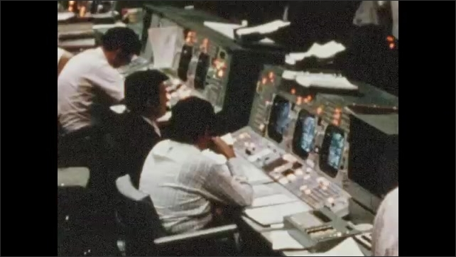 1970s: UNITED STATES: Flight Support and Engineering teams discuss issues on Skylab. Men work at ground control.