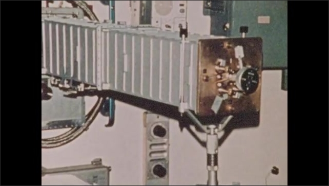 1970s: UNITED STATES: man with headset monitors computers at Houston. Visuals of damage to Skylab One.