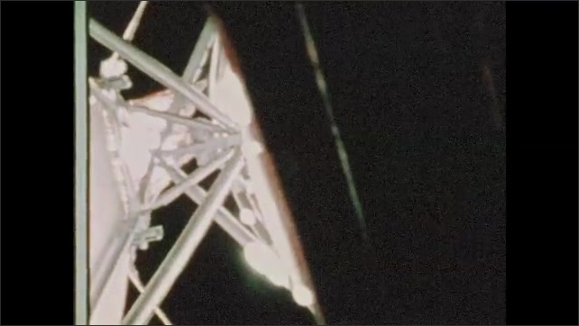 1970s: UNITED STATES: Thermal parasol deployment close to workshop skin. Visuals of Skylab. Houston flight support team.
