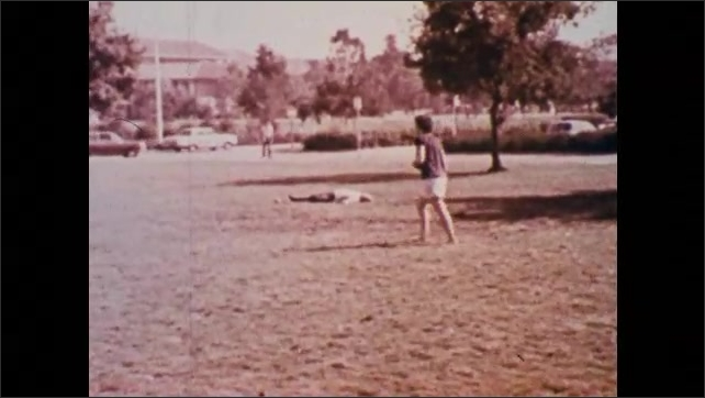1980s: woman in red shirt sits on chair, reads magazine and falls asleep from narcolepsy. man stands in park and collapses. man eats at outside table, loses consciousness and head falls in plate.
