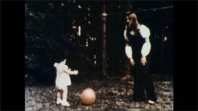 1980s: little girl in dress bounces red ball back and forth to woman in yard near bushes and trees. needles read out wavelengths on graph paper.