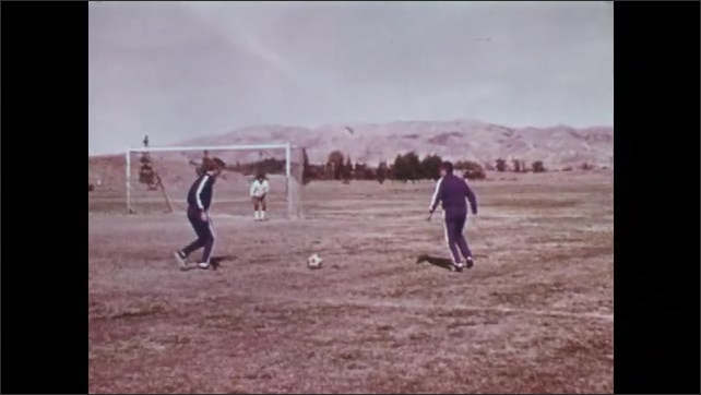 1970s: UNITED STATES: goal keeper dives for ground ball. Goalkeeper blocks ball with body. Goalkeeper in slow motion