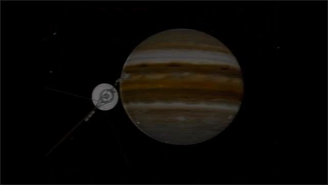 1990s: Tracking shot across moon surface. Animation of satellite passing Jupiter.