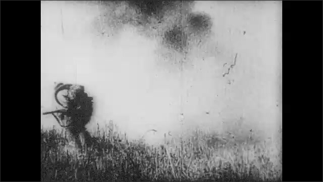 1960s: EUROPE: tank moves across ground. Soldiers run by tanks in war. Pigeons fly in square