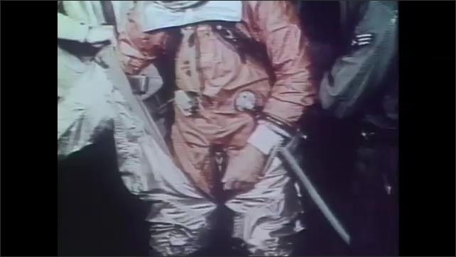 1990s: UNITED STATES: early pressure suit. Man gets into pressure suit.