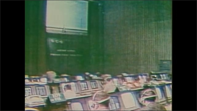1980s: People in Nasa mission control room. Astronauts wait. Countdown clock. Clamp releases from rocket. Mission control. President Richard Nixon and politicians sit around table signing documents.