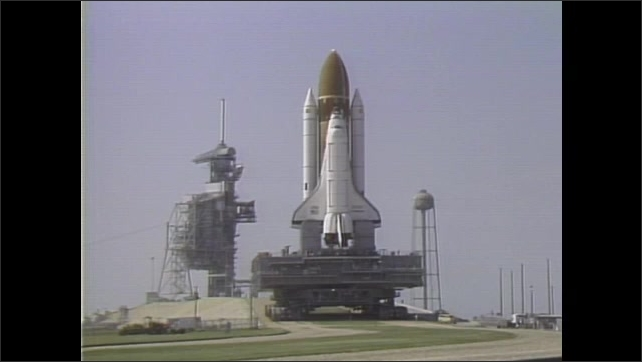 1980s: UNITED STATES: space shuttle on launch pad. Challenger's second flight. Operational mission to space. Mission patch