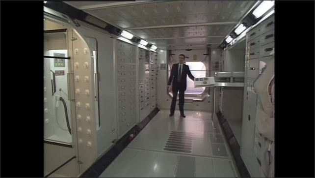 1990s: Man stands inside space station module, talks.