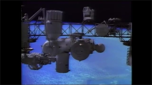 1990s: Animation of space station above Earth.
