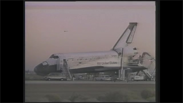 1990s: Two scientists work on experimental plane model in laboratory. Containers in lab. Computer image of lines around Space Shuttle. Space Shuttle on tarmac. Nose of Space Shuttle.