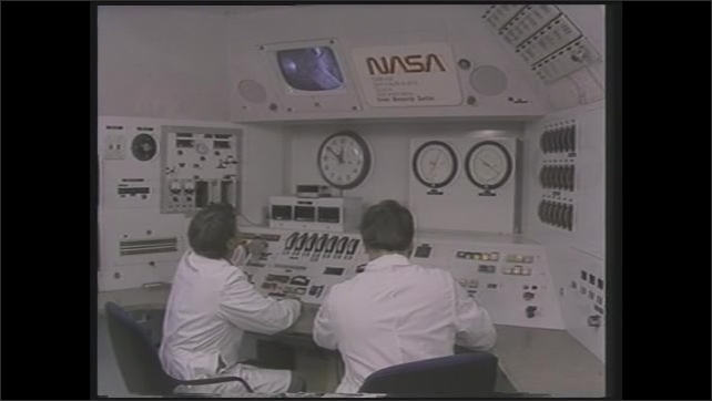 1990s: Tail of Space Shuttle. Scientists sit at controls panels in NASA control room. Animation of astronaut floating in orbit.