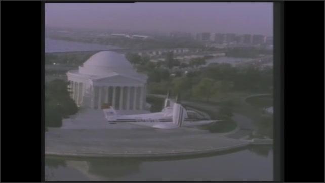 1990s: Pilots flying aircraft. Aircraft flies over Washington D.C.. Pilots flying aircraft. Flying over Washington D.C.. Pilots flying.