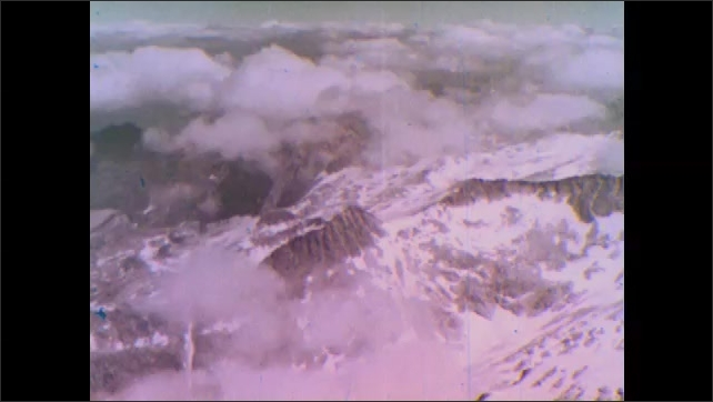1950s: Snowy mountains.  Clouds.