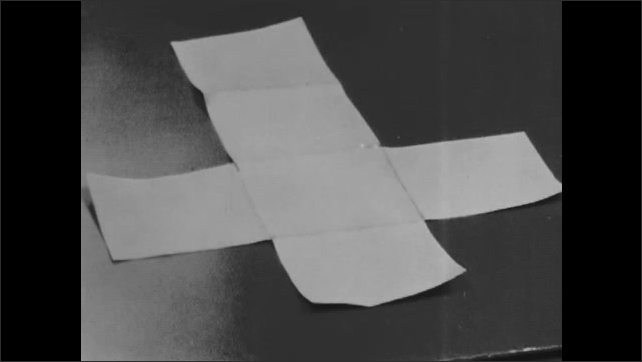 1960s: Thin paper coating of the 3x3 cube model is removed, unfolded and laid flat. Thin paper coating of the 1x1 cube model is removed, unfolded and laid flat on top of the larger cube.