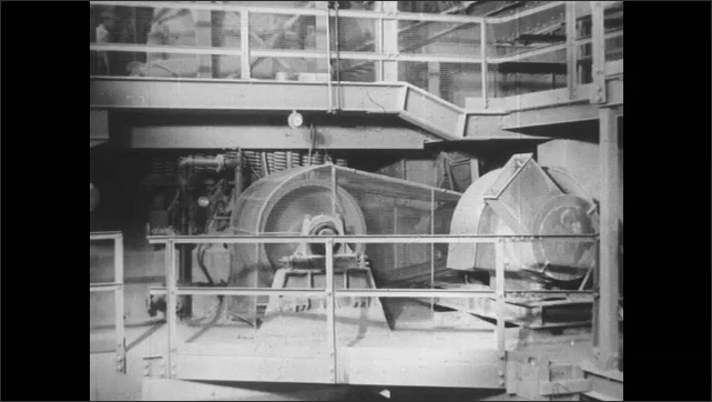 1950s: UNITED STATES: ore on conveyor belt. Ore travels to secondary crushing unit. Ore broken into smaller pieces. Screening plant. Two cone crushers in processing plant