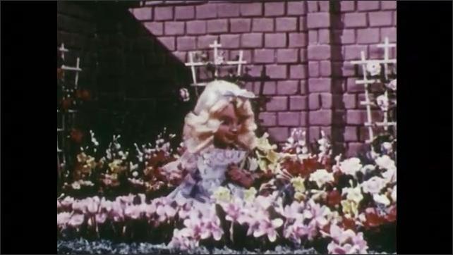 1950s: Girl stands in garden.  Girl holds flowers.  Girl sits.  King joins girl.