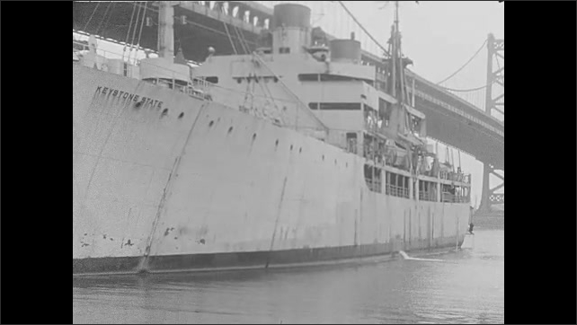 1930s: UNITED STATES: ship tied to dock
