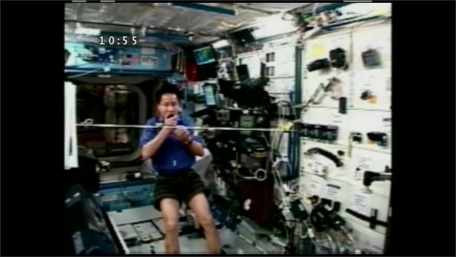 1990s: UNITED STATES: astronaut moves string in up and down motion.