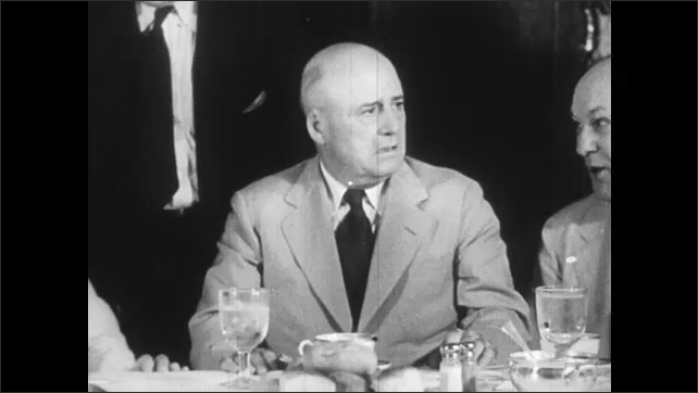 1940s: old man in suit, capitol building dome rising above trees, men sitting around table eating and talking, men in military uniform talking and smoking