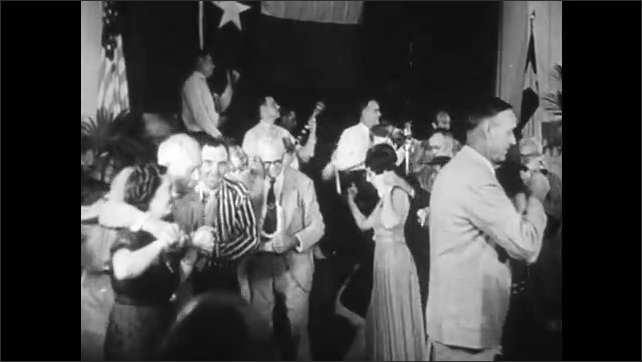 1940s: band playing on stage while people dance