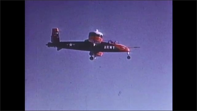 1960s: Short takeoff aircraft rises from runway. Small army aircraft in sky above runway. Research propeller aircraft in sky.