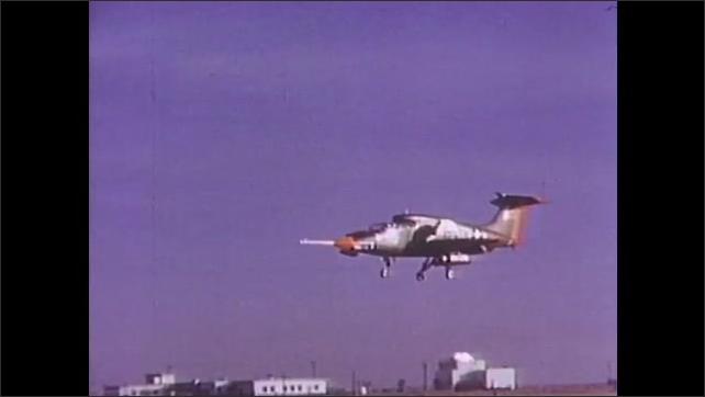 1960s: Aircraft hovers off runway. Aircraft at facility runway spins in air. Propeller aircraft in sky.