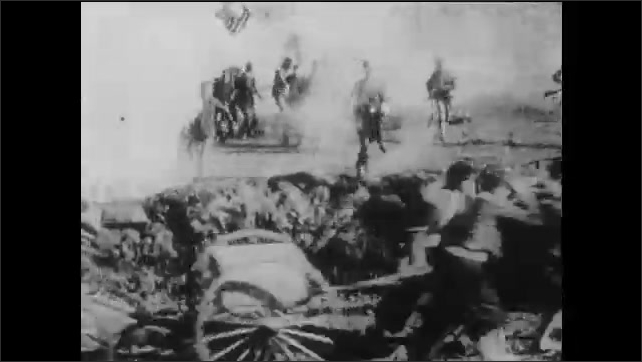 1910s: Confederate soldiers charge over Union troops line with cannons and grab USA flags. men retreat beyond explosions. officers talks in battle and smoke cigars. military men fire rifles.